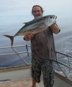 Danny with his first small yellowfin