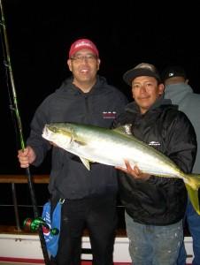 Dean Okamura, with deckhand Axel